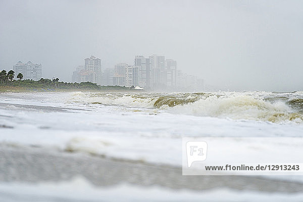 USA  Florida  Naples  Vanderbilt Beach  waves and spray after hurricane Harvey in front of hotel buildings