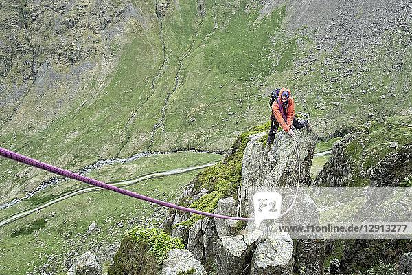 UK  Lake District  Longsleddale valley  Buckbarrow Crag  man climbing on rock