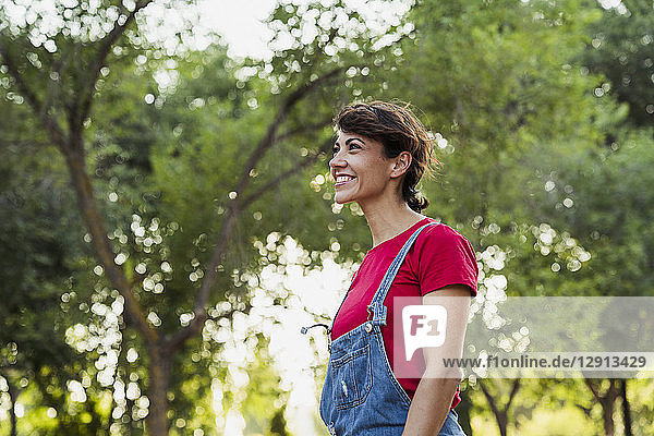 Smiling woman relaxing in nature