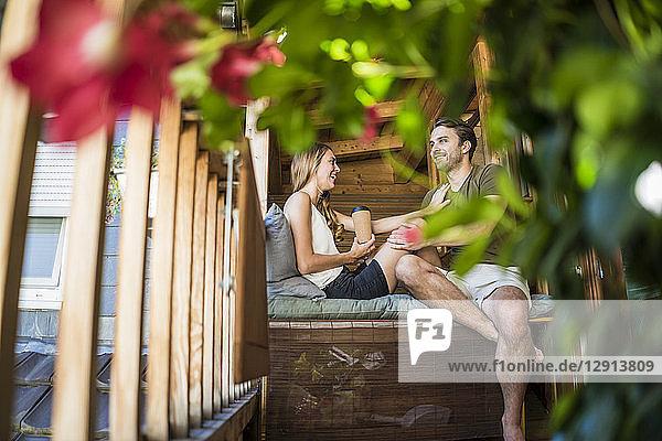 Happy couple relaxing on balcony