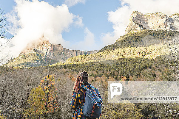 Spain  Ordesa y Monte Perdido National Park  back view of woman with backpack looking at view