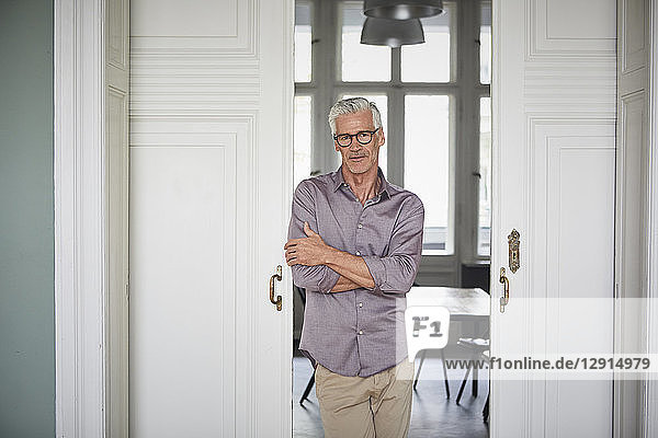 Portrait of confident mature man at home