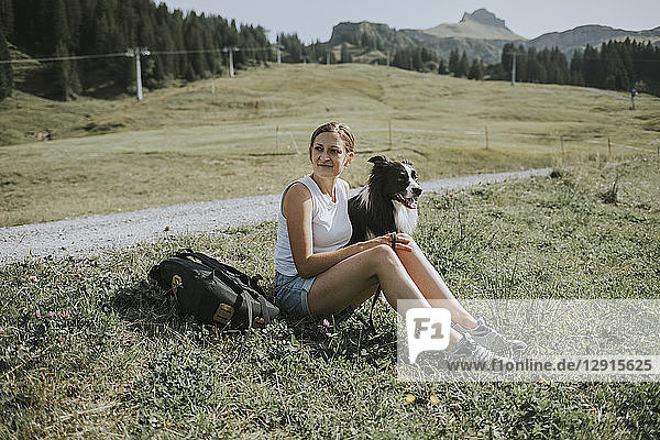 Austria  Vorarlberg  Mellau  woman with dog on a trip in the mountains