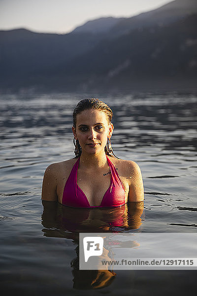 Portrait of beautiful young woman in a lake