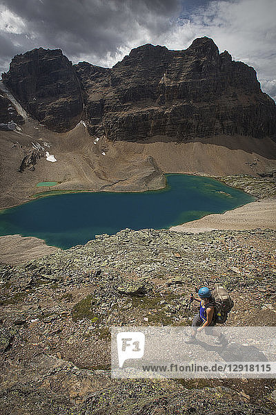 View of person hiking near lake in Canadian Rockies  Yoho National Park  Alberta  Canada