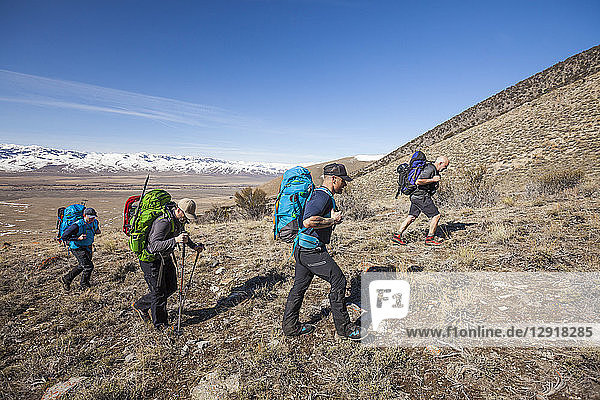 Group of mountaineers on approach to Donaldson Peak in the Lost River Mountain Range  Idaho  USA