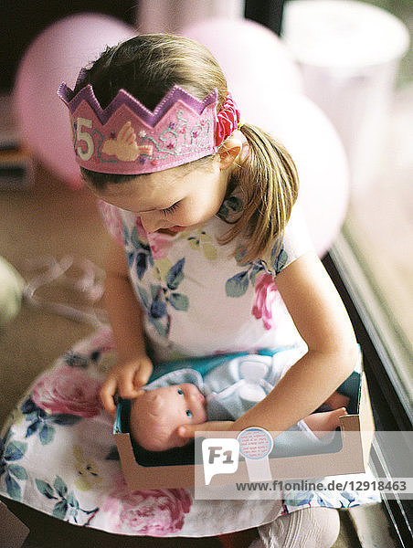 Girl opening presents during birthday