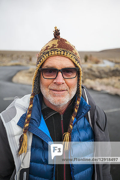 Head and shoulders portrait of mountain climber in knit hat