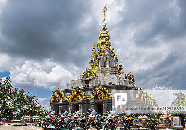 Group of motorcycles parked near stupa  Nan  Mueang Chiang Rai District  Thailand