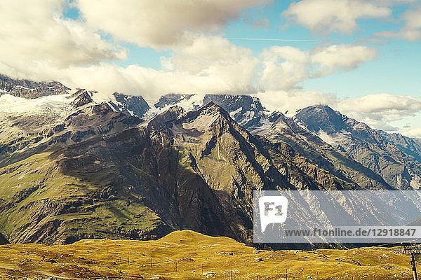Picturesque landscape with Alps summits among clouds  Zermatt  Valais  Switzerland