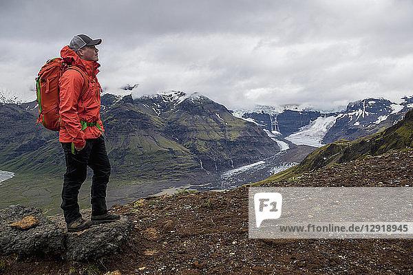 Mountain view with hiker admiring Vatnajokull glacier in Skaftafell  Skaftafell  Iceland