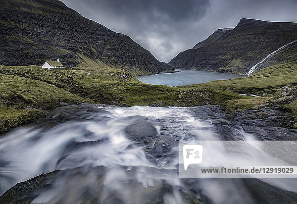Scenic landscape with mountains and stream,  Saksun,  Faroe Islands