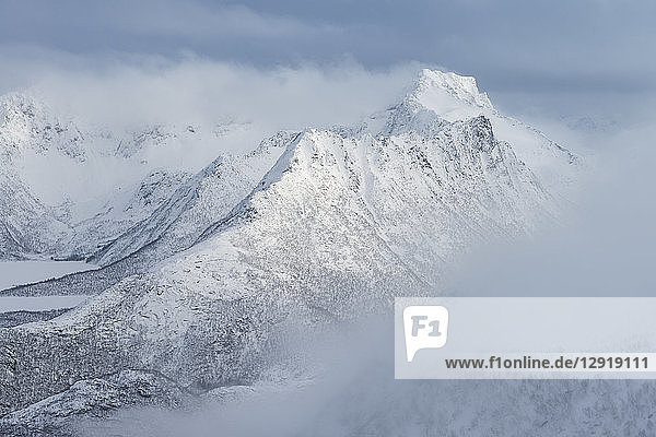 Majestic natural scenery of Breidtind mountain peak in winter  Austvagoy  Lofoten Islands  Norway