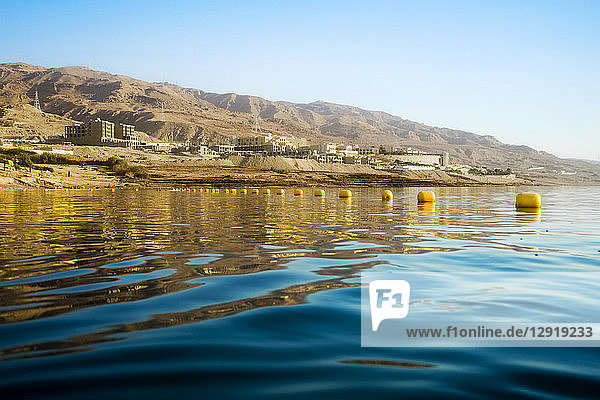 View from water of Dead Sea shoreline in Madaba Governorate  Jordan