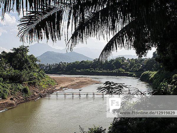 Nam Kang River with mountains  bamboo bridge  and palm trees  Luang Prabang  Laos  Indochina  Southeast Asia  Asia