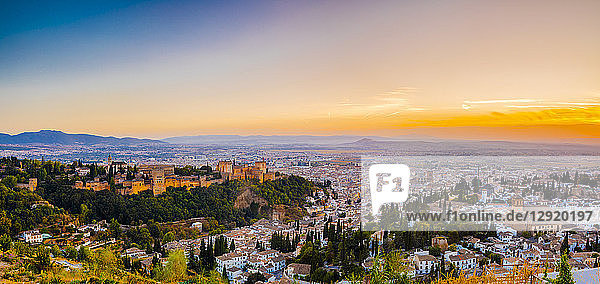 View of Alhambra  UNESCO World Heritage Site  and Sierra Nevada mountains at dusk  Granada  Andalucia  Spain  Europe