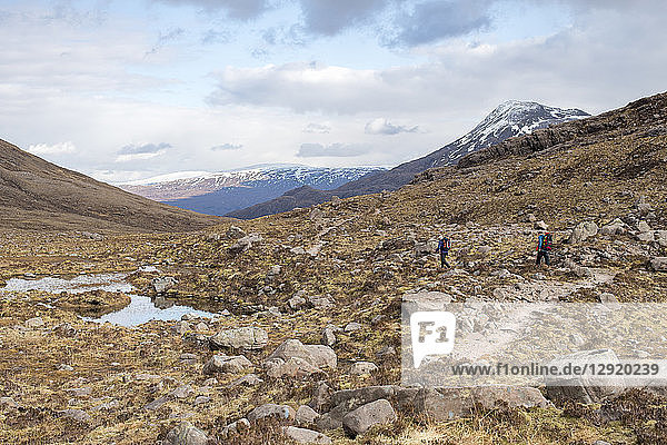 Hiking in the Scottish Highlands in Torridon along The Cape Wrath Trail towards Loch Coire Mhic Fhearchair  Highlands  Scotland  United Kingdom