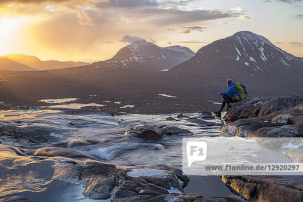 Hiking in the Scottish Highlands in Torridon along The Cape Wrath Trail near Loch Coire Mhic Fhearchair  Highlands  Scotland  United Kingdom