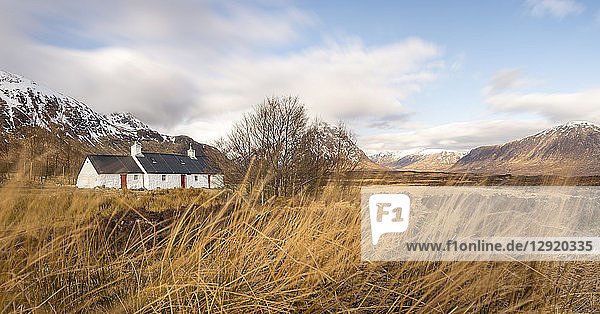 Black Rock Cottage and Buachaille Etive Mor in the Scottish Highlands along the West Highland Way near Glen Coe  Highlands  Scotland  United Kingdom