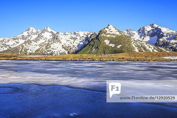 Ice melting at Lake Andossi during thaw  Chiavenna Valley  Spluga Valley  Sondrio province  Valtellina  Lombardy  Italy