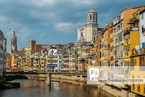 Colourful houses on the embankment of the River Onyar in historic centre with Girona's Cathedral in the background on right  Girona  Catalonia  Spain  Europe
