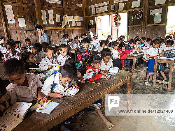 Primary school classroom full of students  Houy Mieng village  Laos  Indochina  Southeast Asia  Asia