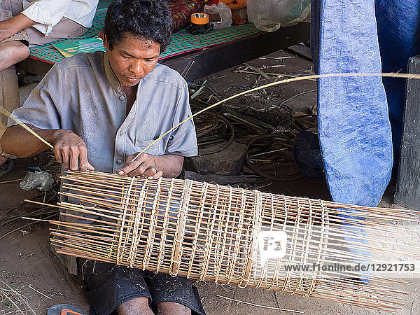 Man making a fish trap  village near Siem Reap  Cambodia  Indochina  Southeast Asia  Asia