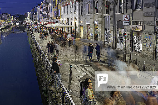 Navigli district at night with crowd on the banks of Naviglio Grande Canal  Milan  Lombardy  Italy  Europe