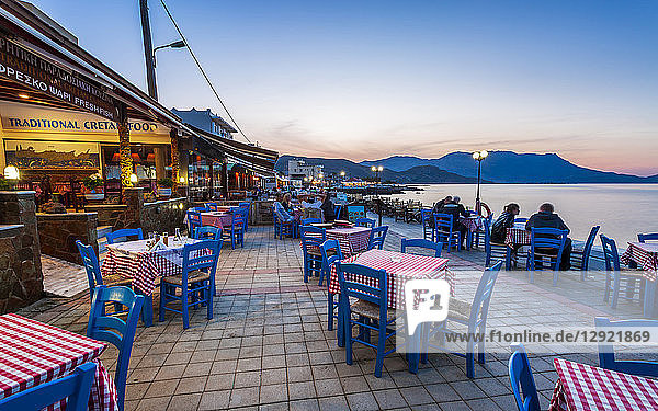 Traditional Cretan Food Restaurant at Paraliaki promenade at sunset in Kissamos  Crete  Greek Islands  Greece