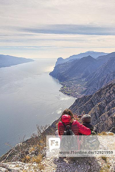A couple take a photo at Cima Larici  Riva del Garda  Lake Garda  Trento province  Trentino-Alto Adige  Italian Lakes  Italy