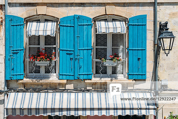 Traditional Provencal building facade in the historic centre of Arles  a city on the Rhone River in Provence  France  Europe
