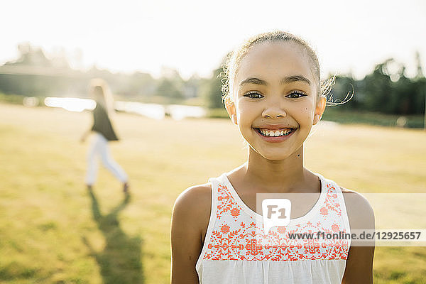 Portrait of smiling girl outside in park