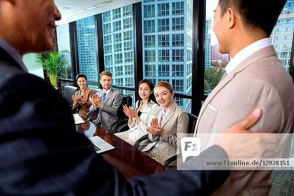 Business men and women in a meeting