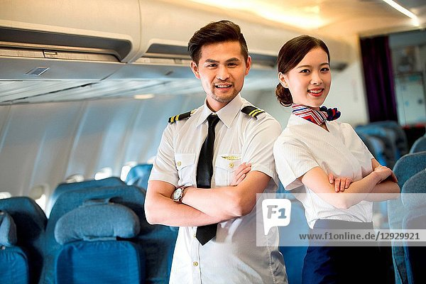 Two flight attendants in the cabin