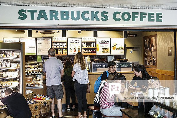 United Kingdom Great Britain England  London  South Bank  Waterloo Station  Starbucks Coffee  cafe coffee house  Asian  family  woman  girl  man  line  queue  counter