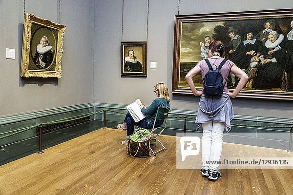 United Kingdom Great Britain England  London  Trafalgar Square  The National Gallery  art museum  inside interior  painting  Frans Hals A Family Group in a Landscape  Portrait of a Man in his Thirties  woman  artist  copyist  drawing  sitting