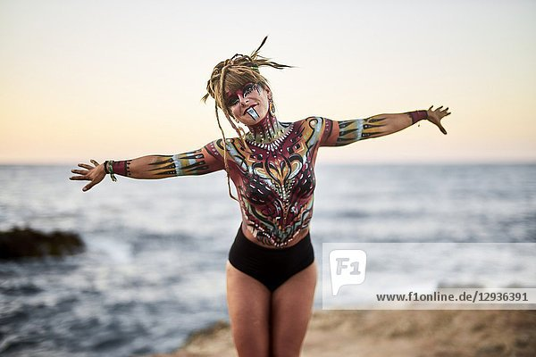 Dancing woman with body painting on the beach  topless  Hersonissos  Crete  Greece