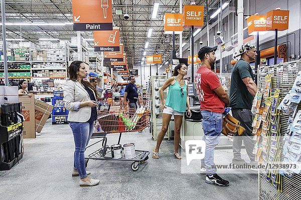 Florida  Miami  Home Depot  inside  shopping  self checkout line queue  man  woman  waiting