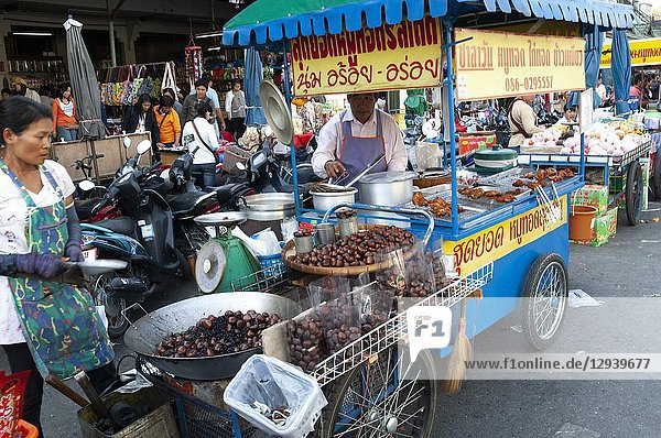 Selling roasted chestnuts in Chiang Rai  Northerh Thailand.