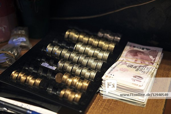 Turkish currency-Turkish Liras and coins on cash counter.