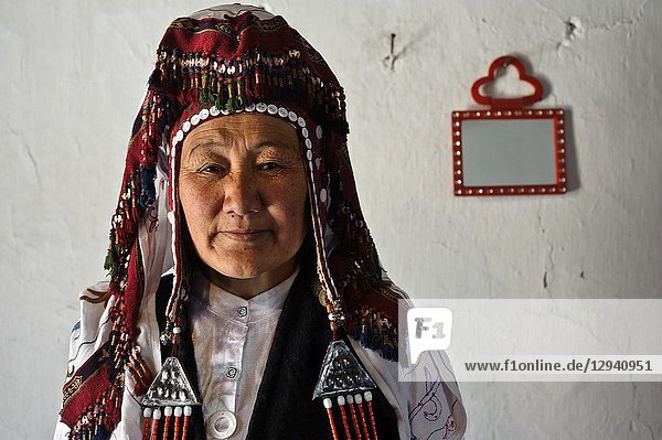 Traditionally dressed woman belonging to the kyrgyz ethnic group ( Kyrgyzstan).
