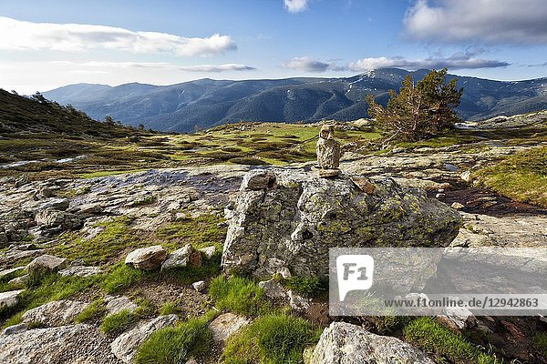 Milestone at National Park of Penialara Lagoons and Cuerda Larga on the background. Sierra de Guadarrama. Madrid. Spain.