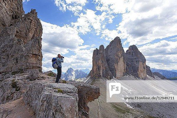 A photographer at Passaporto Fork  Dolomites  Auronzo di Cadore  Belluno  Veneto  Italy.