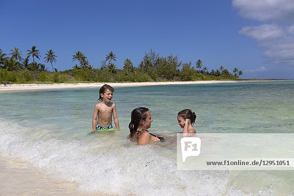 Family in the beach  Twin Cove Beach  Eleuthera island  Bahamas.