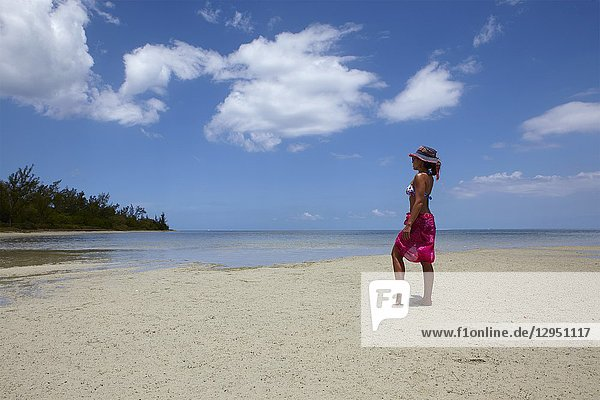Girl on the beach of Ile aux Benitiers  Mauritius.