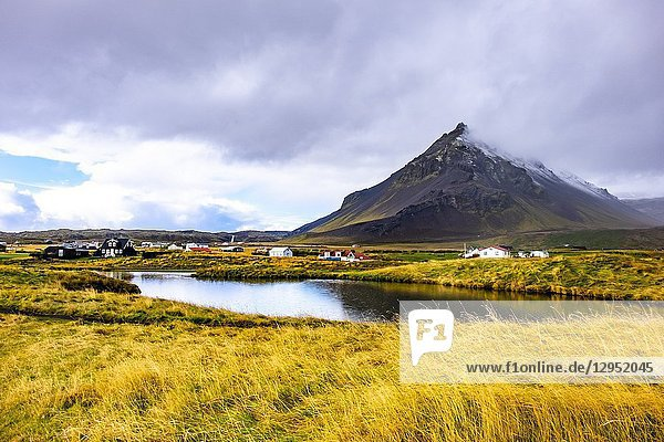 Mt. Stapafell reflected in the pond at Arnarstapi  Snaefellsnes peninsula  Iceland.