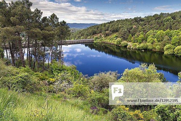 Reflections at Pajarero reservoir. Sierra de Grados. Avila. Spain