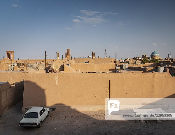 Downtown rooftops wind towers and landscape view of yazd city old town in iran.