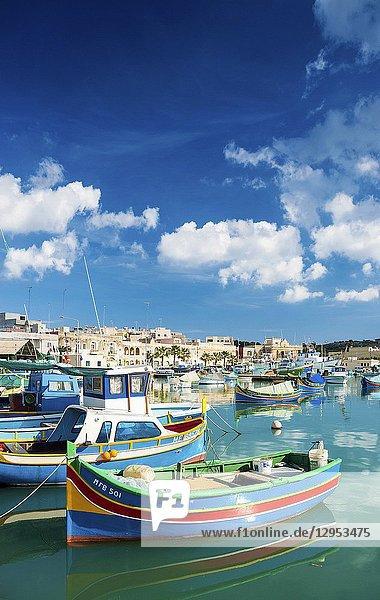 Marsaxlokk harbour and traditional mediterranean fishing boats in malta island.