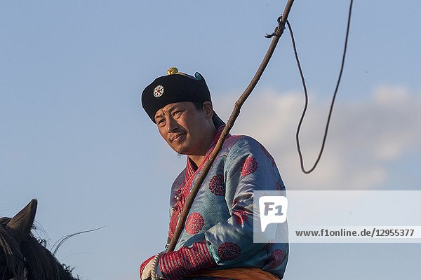 China  Inner Mongolia  Hebei Province  Zhangjiakou  Bashang Grassland  Mongolian man traditionnaly dressed with his horse.